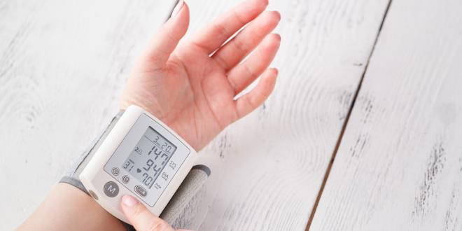 Woman is taking care for health with hearth beat monitor and blood pressure.